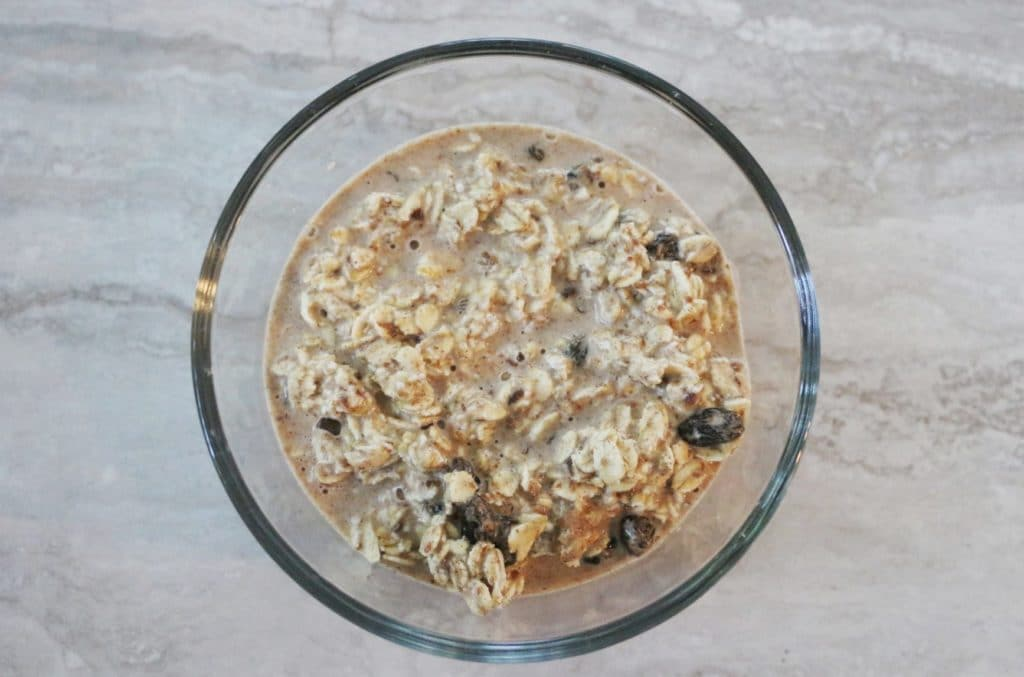 making overnight oats in a glass bowl
