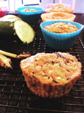 zucchini muffin in bright blue muffin holders