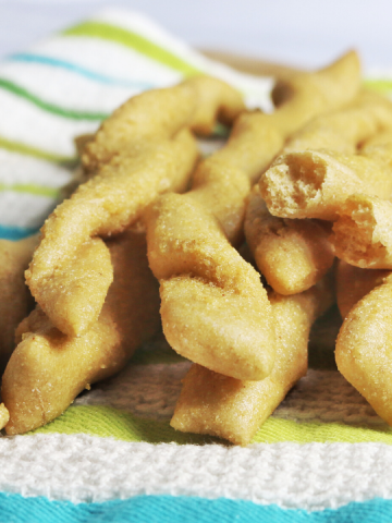 twisted breadsticks on a white blue and green towel