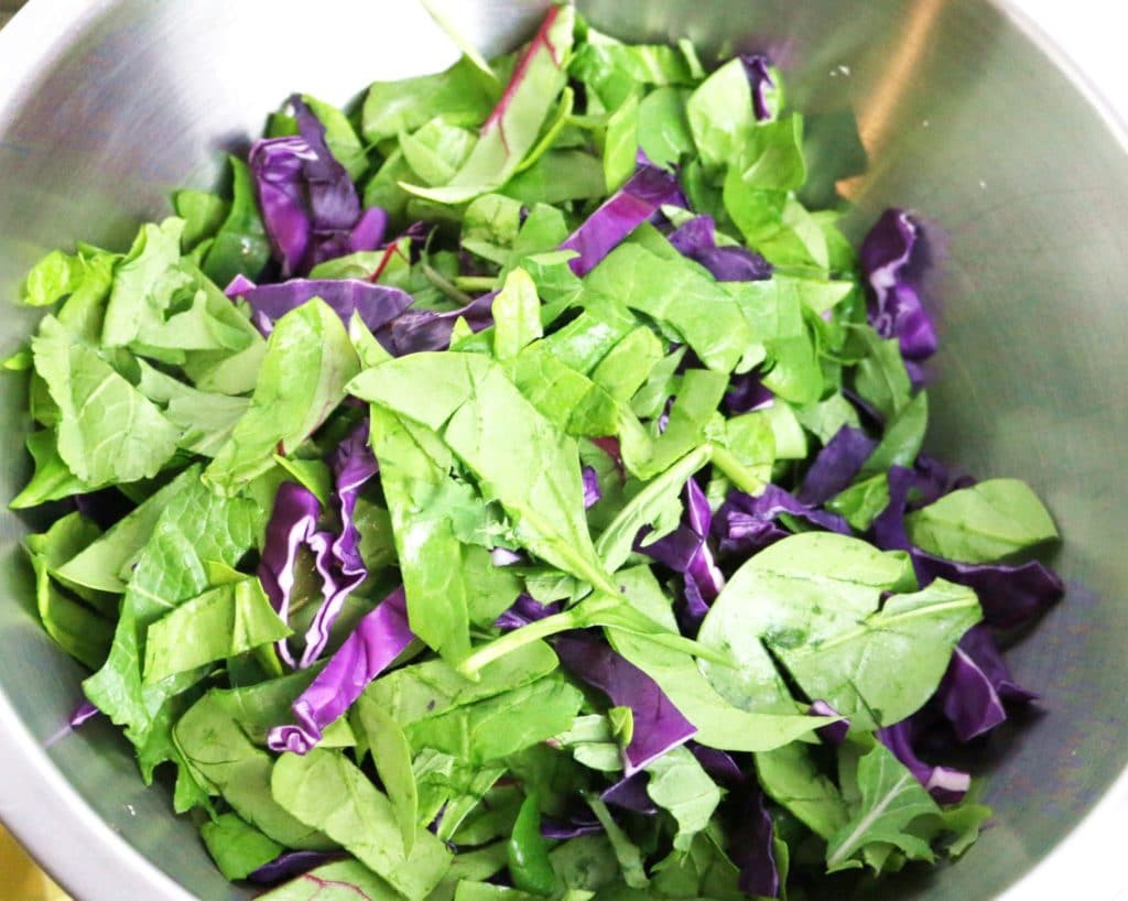 making Chinese chicken salad using healthy greens and cabbage