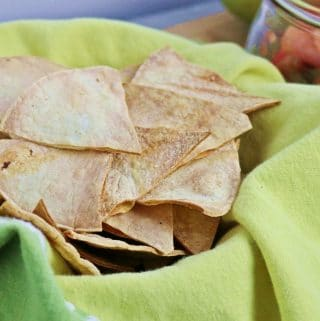 homemade tortilla chips on green linen napkin