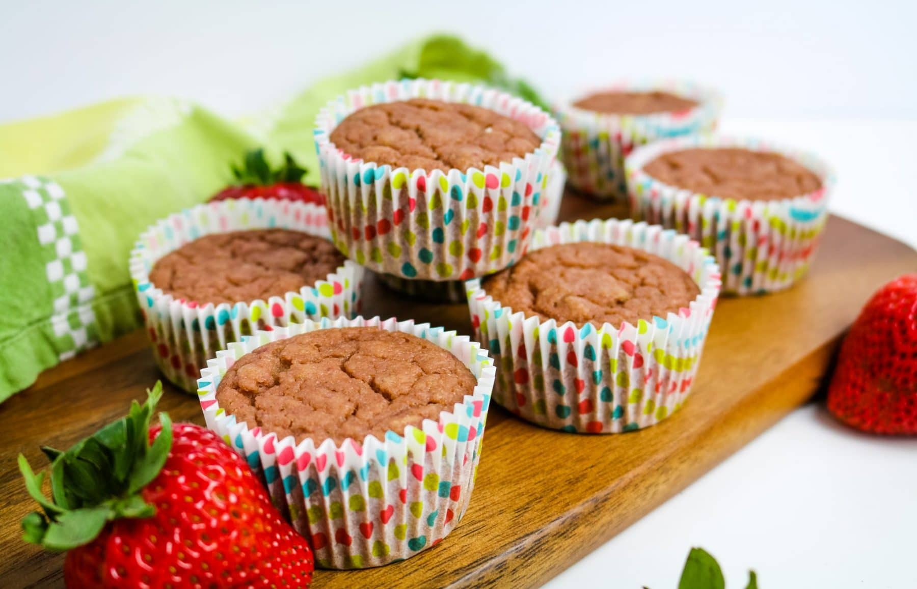 strawberry muffins arranged on a board