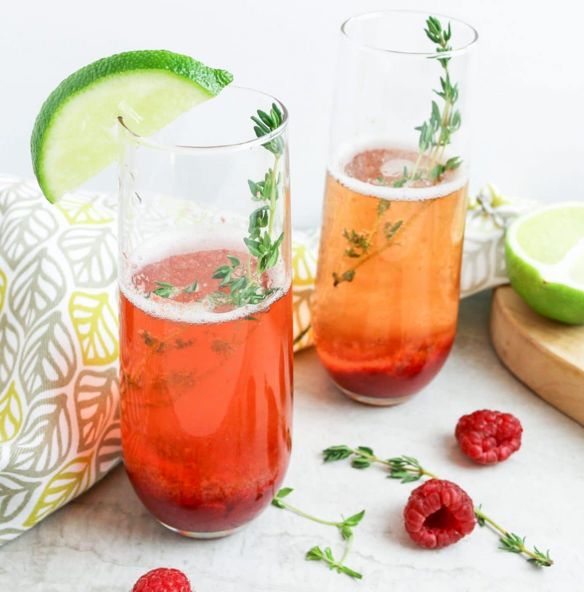 picture of berry champagne cocktails with thyme sprig
