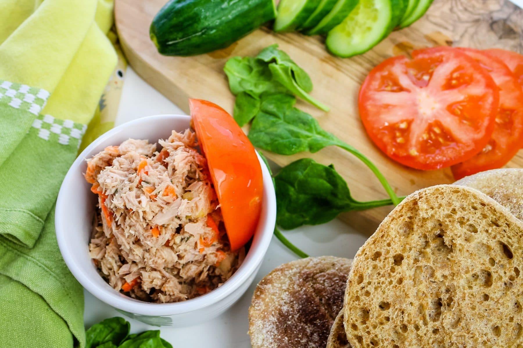 tuna salad in a bowl with tomato slice