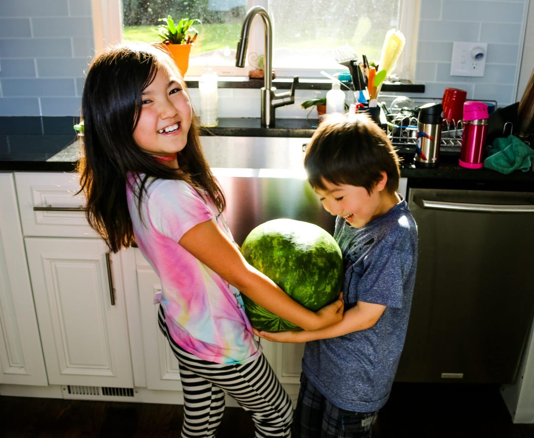 kids holding a watermelon