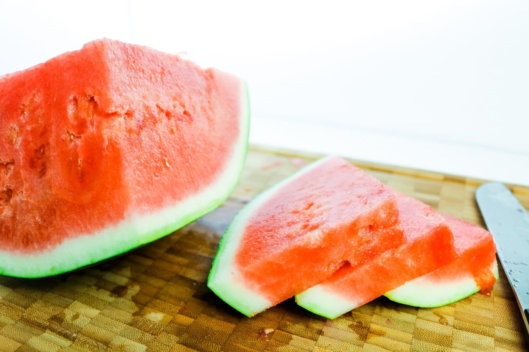 sliced watermelon on cutting board
