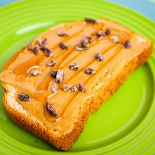 peanut butter and honey toast on green plate