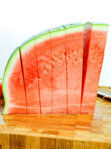 side view of a quarter watermelon cut in to slices