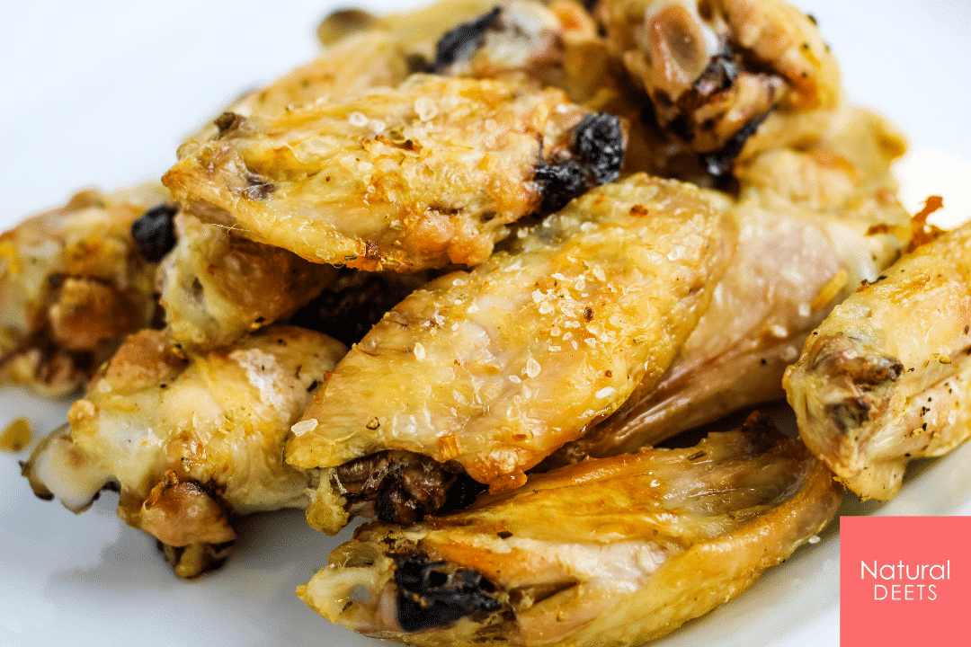 picture of baked chicken wings on a white plate
