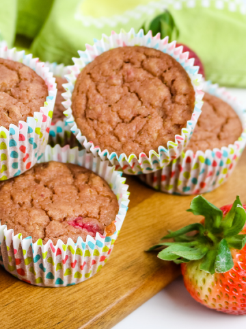 strawberry muffins in colorful wrappers