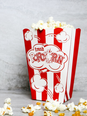 popcorn in a red and white popcorn box