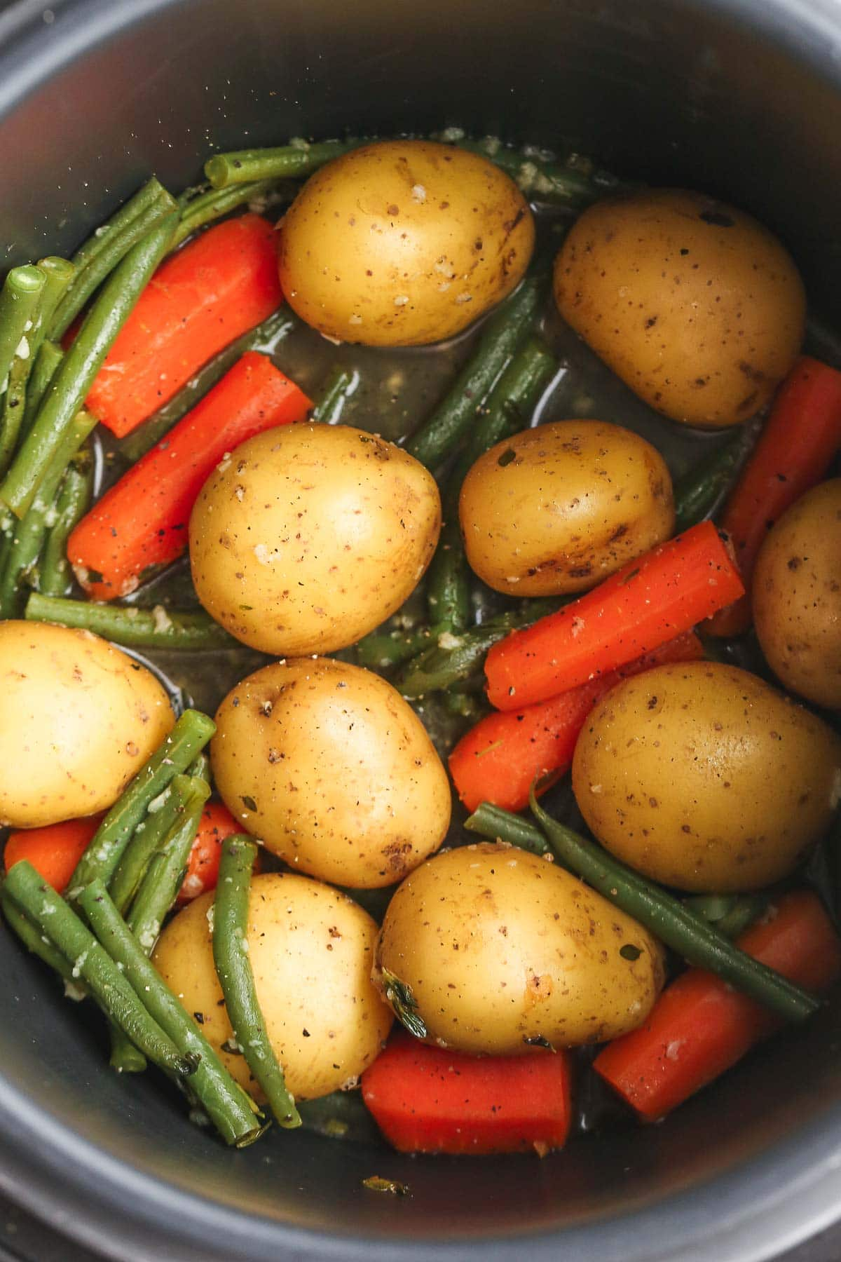 a picture of potatoes and vegetables in an instant pot