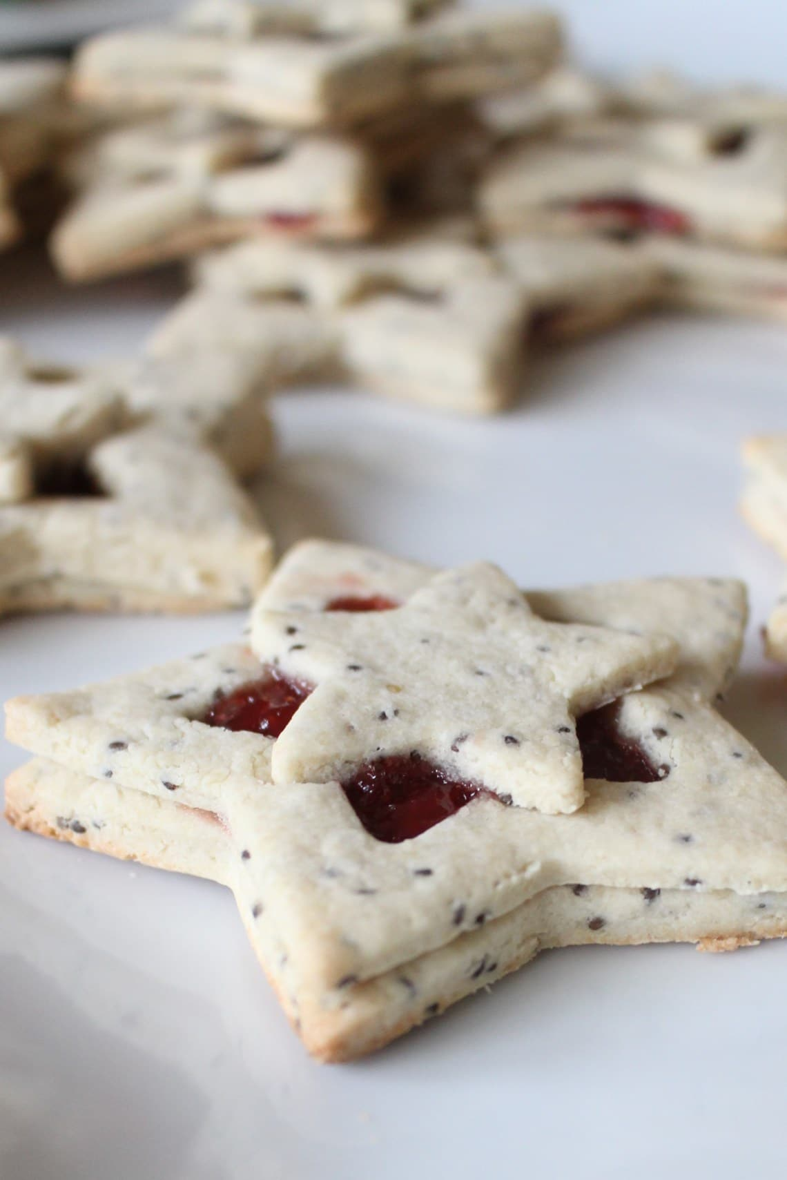 cut out cookies in teh shape of stars with strawberry jelly