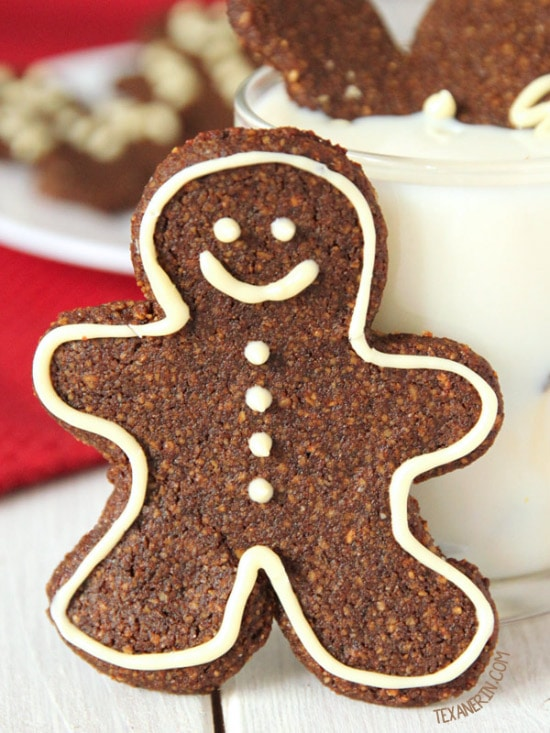 gingerbread men with white icing around the edges and to make the face