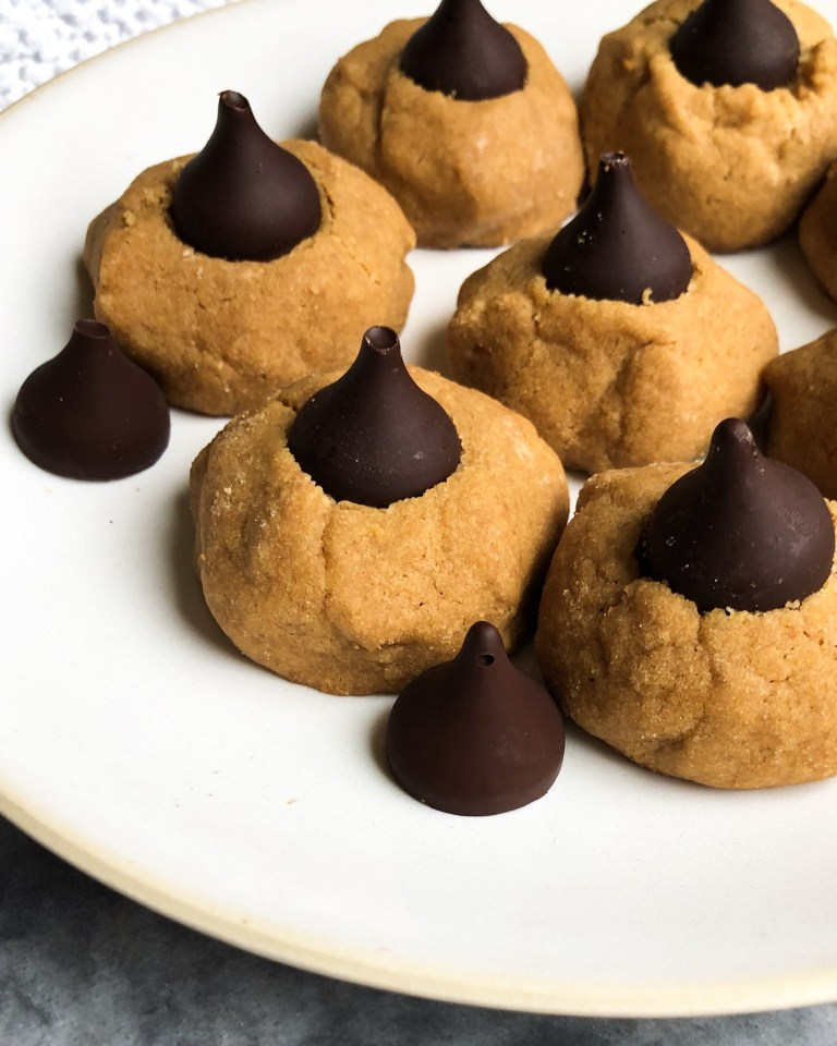 round peanut butter cookies with a homemade chocolate kiss in the middle