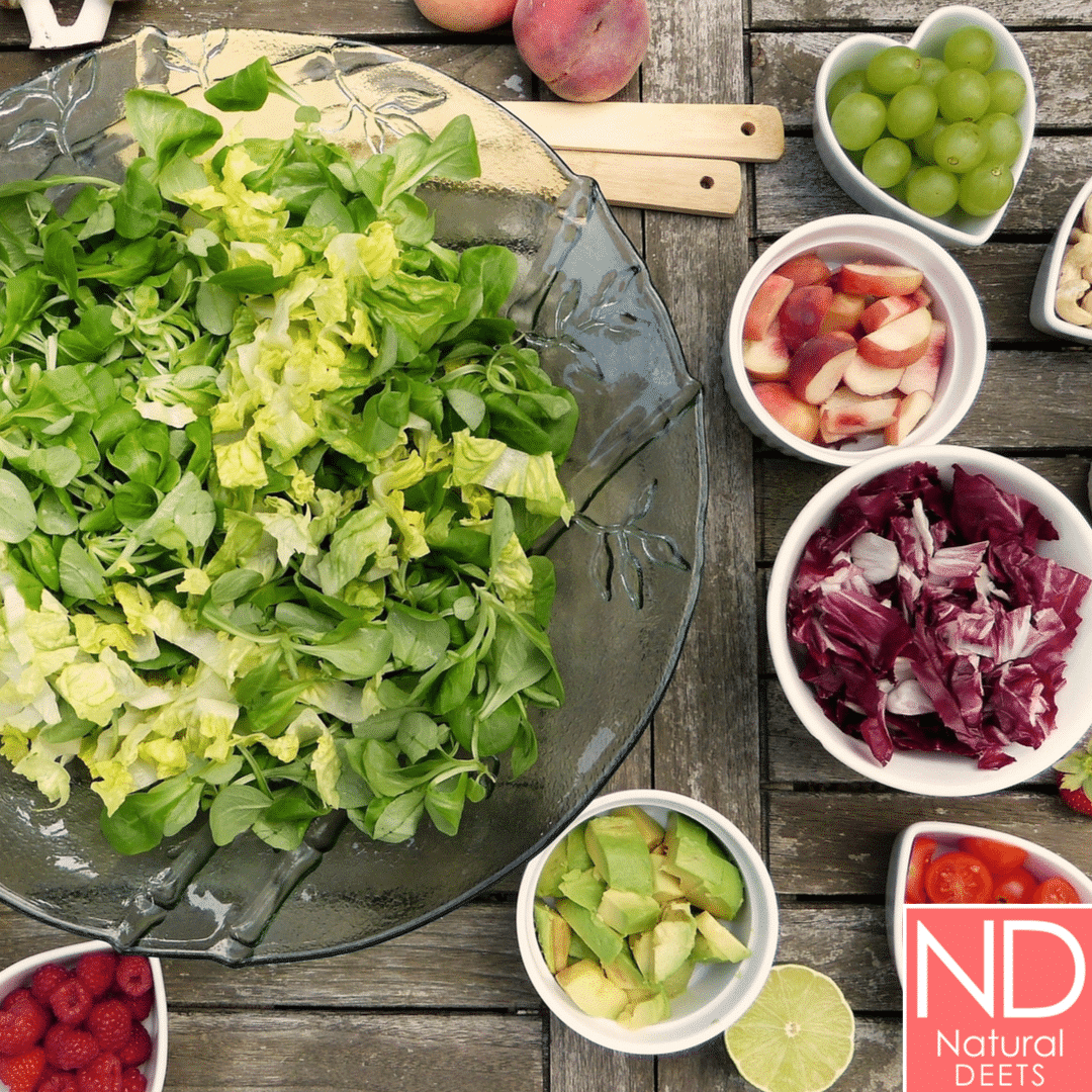 a picture of chopped vegetables like romaine, purple cabbage, strawberries and celery