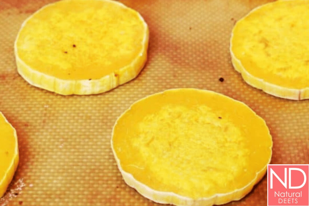 butternut squash sliced into thin circles and roasted on a pan