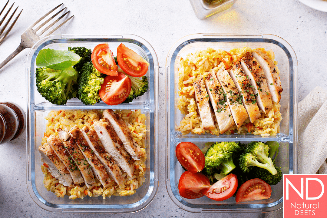 2 glass containers with chicken, couscous and vegetables