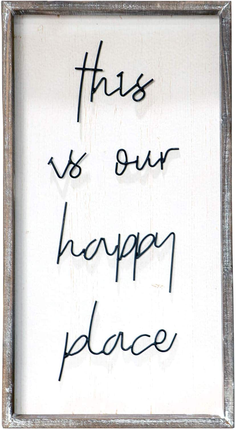 a wooden sign that says this is our happy place on a white background