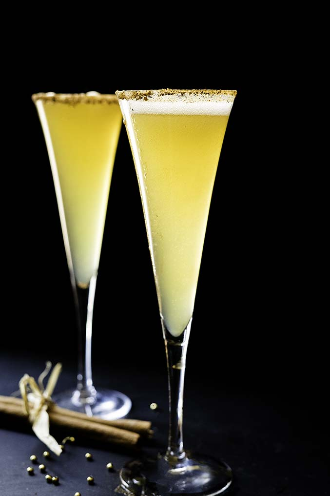 two champagne flutes with champagne