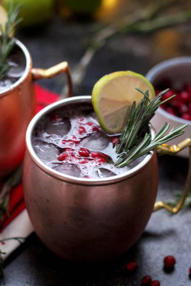 cranberry colored alcohol in a  moxcow mule mug