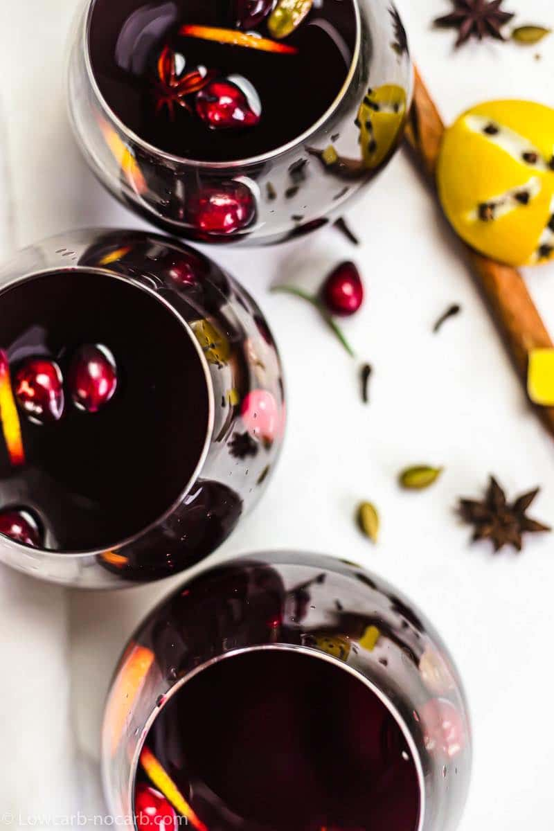 an overhead picture of dark red mulled wine in glasses