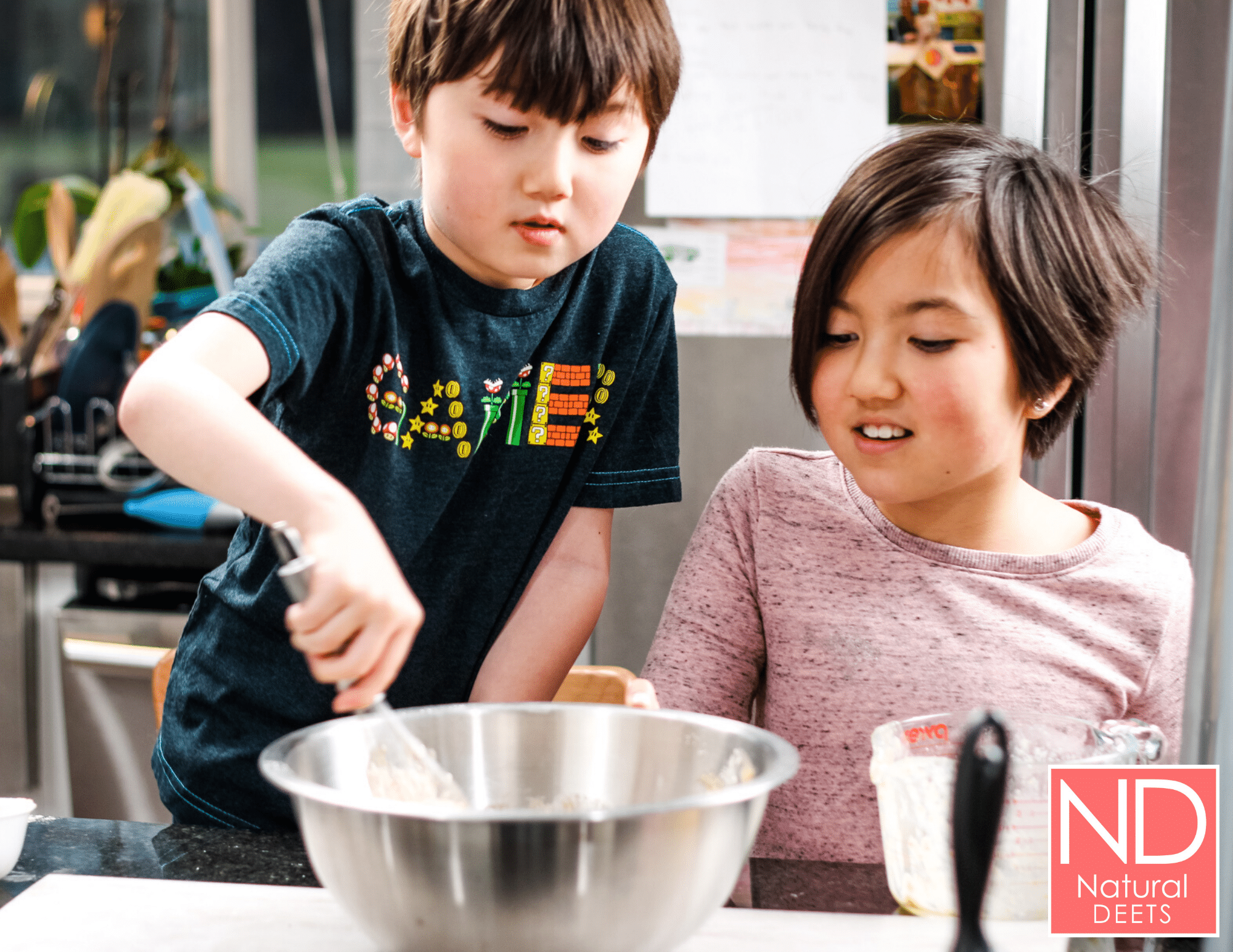 two kids mixing banana bread batter