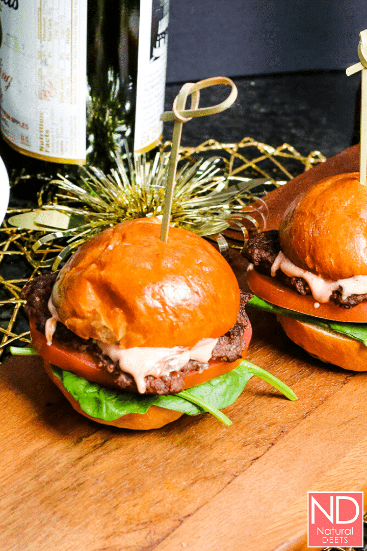 picture of 2 burger sliders on a wooden cutting board