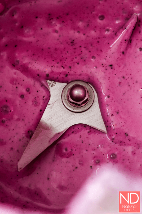 a top view of blueberry colored yogurt in a blender