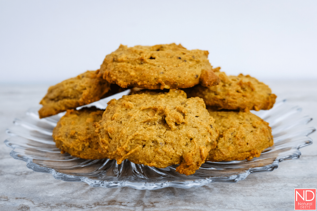 a glass plate full of peanut butter cookies