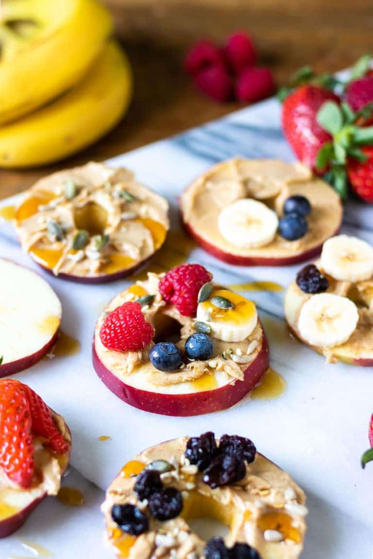 apple slices with peanut butter, berries and honey