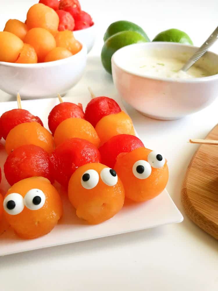 picture of orange and red melon balls in the shape of a worm