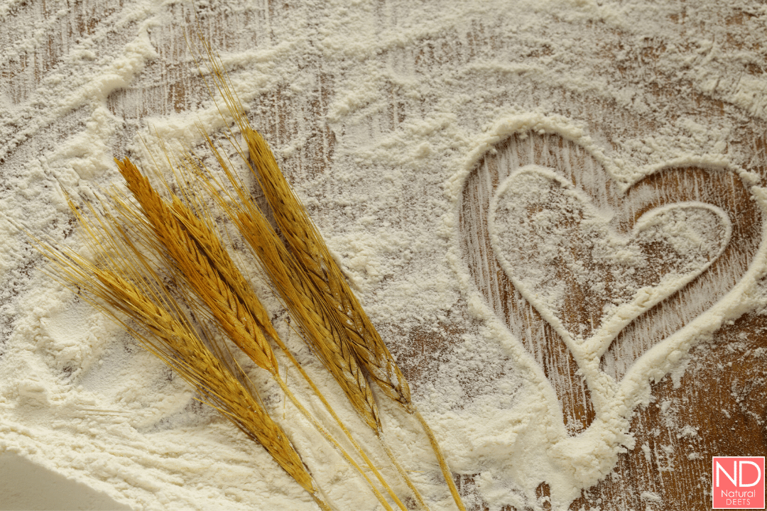 flour on a cutting board with a heart drawn in it