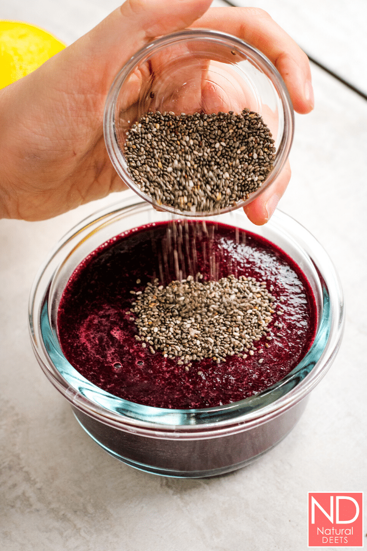 Pouring chia seeds into the jam