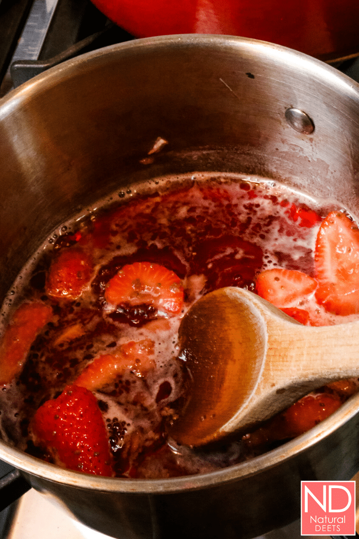 top down view of a saucepan with the juice and fruits as the fruits soften