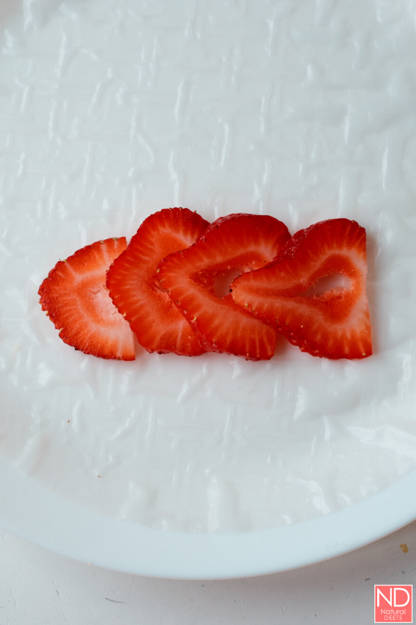 strawberry slices on a rice paper wrapper