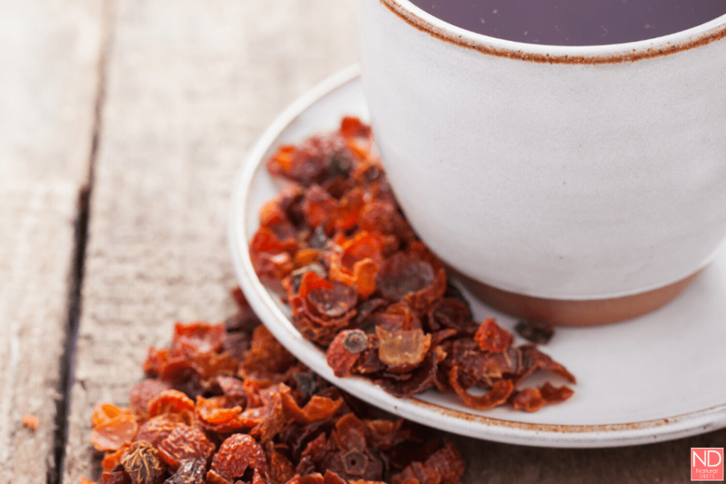 cup of rosehip tea with leaves