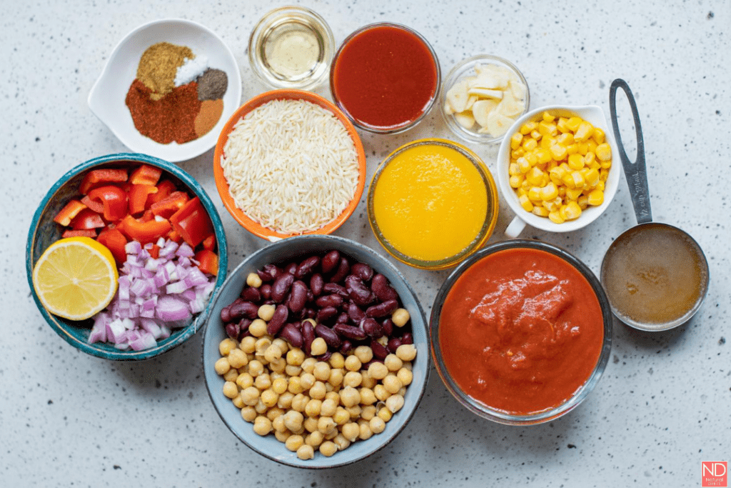 a top view of all the ingredients needed to make pumpkin chili. It shows all the ingredients in the ingredient list