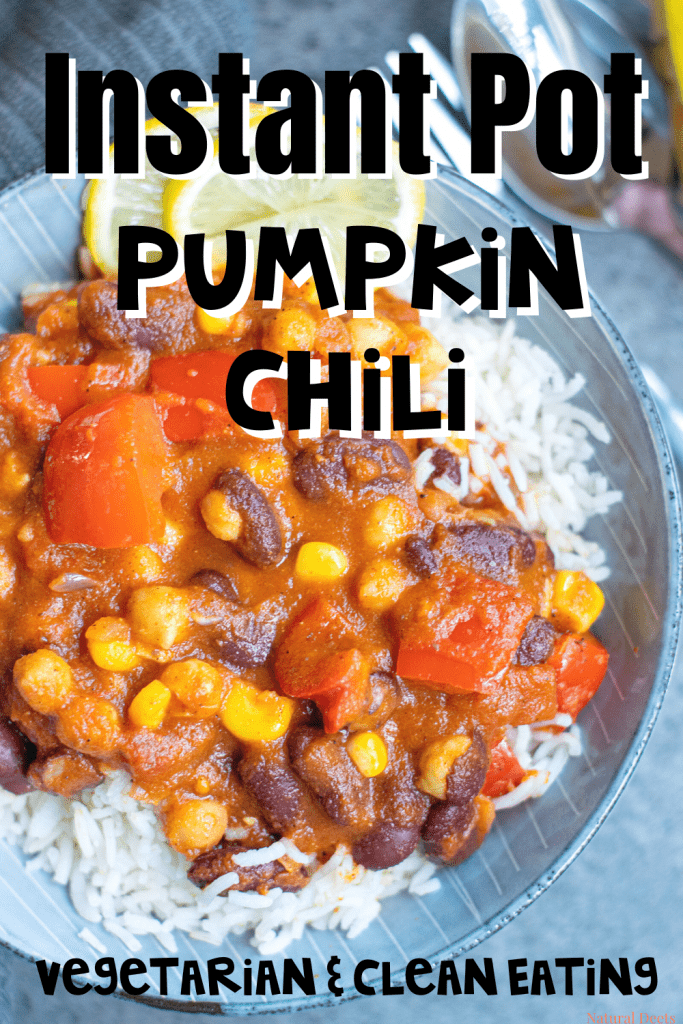 top view of pumpkin chili over rice with corn and beans