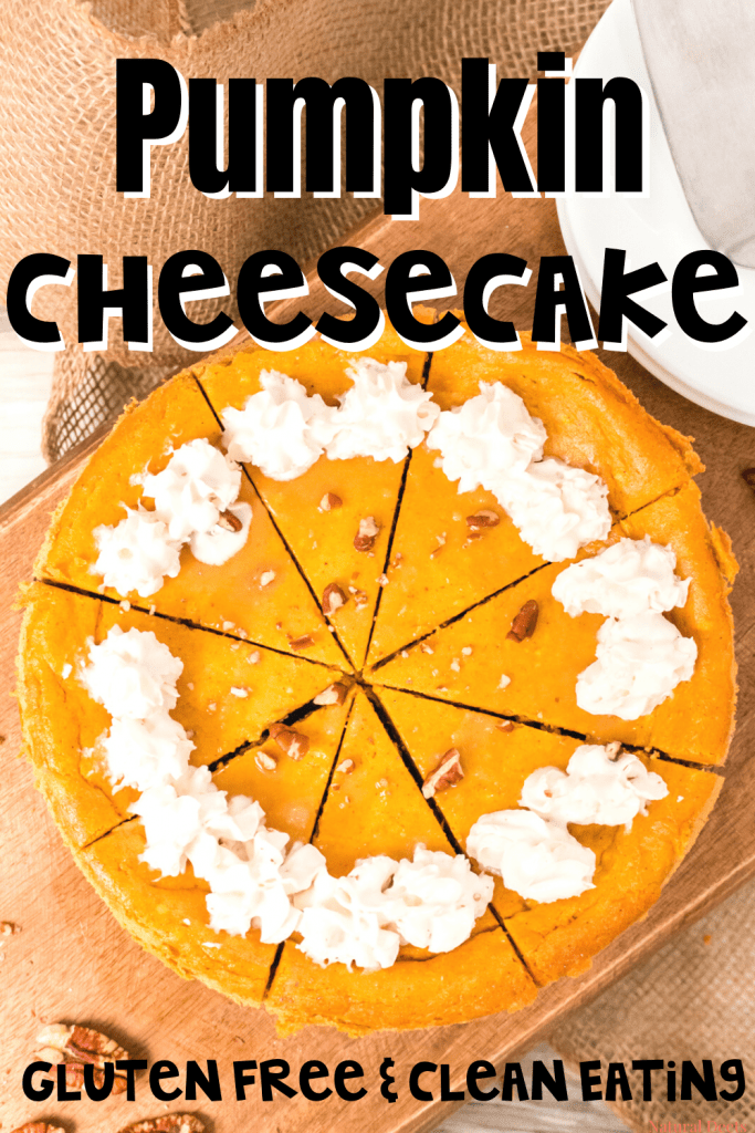 a top view of the pumpkin cheesecake sliced with whipped cream